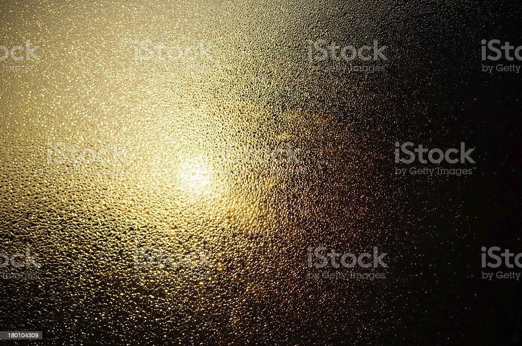 the sun shines through  drops of water stock photo