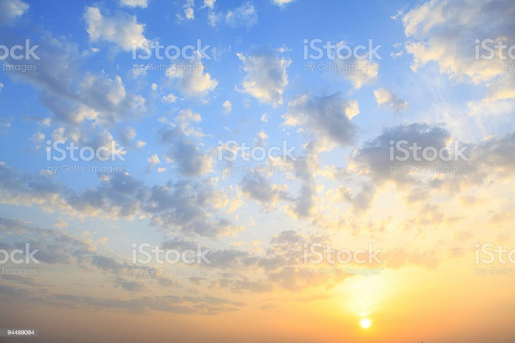 the sun shining through low cloud royalty-free stock photo