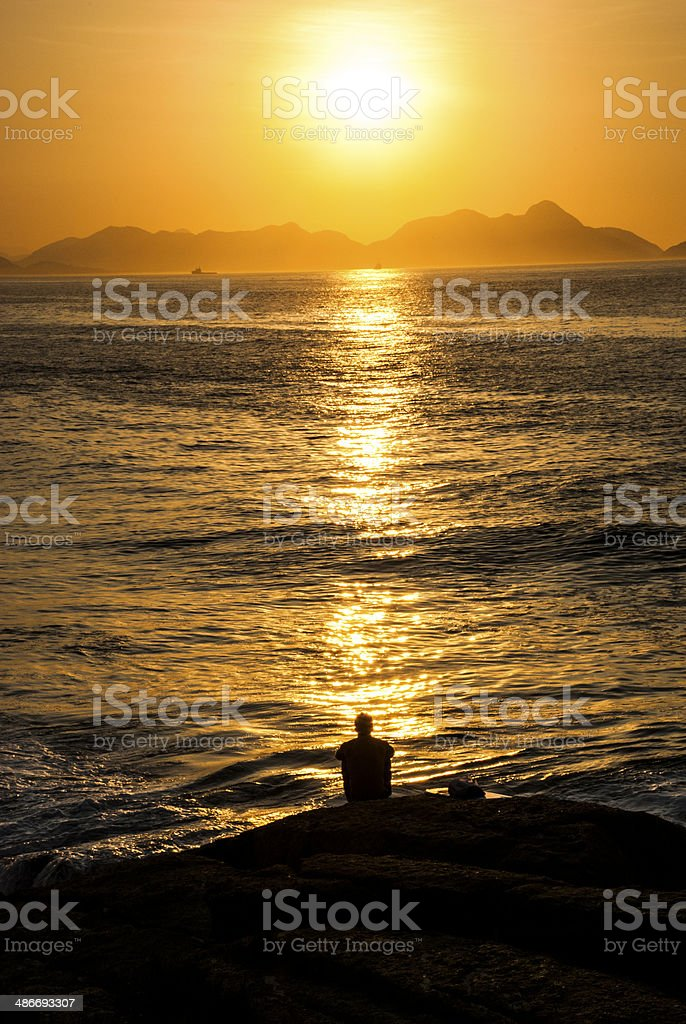The Sun, the Sea and the Man royalty-free stock photo