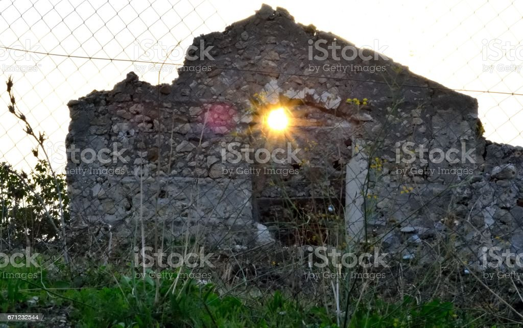 The sun through the window of a ruined cottage in Sicily stock photo