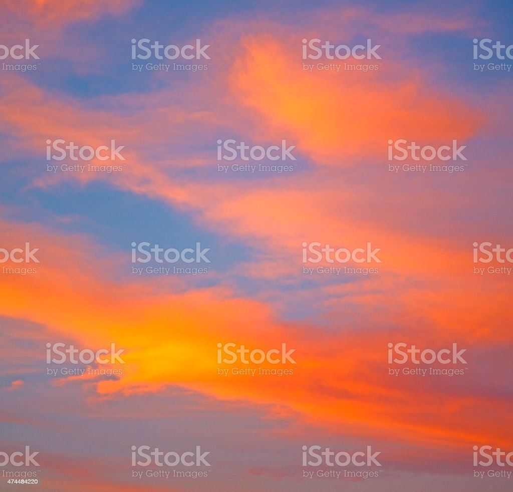 the sunrise in  colored sky white soft clouds stock photo