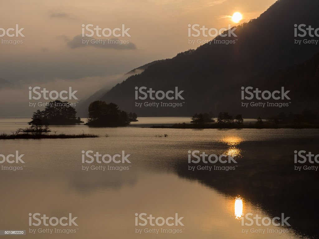 The sunrise of the Lake Akimoto of Urabandai in japan stock photo