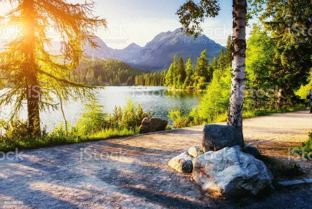 The sunrise over a lake in the park High Tatras. Shtrbske Pleso, stock photo