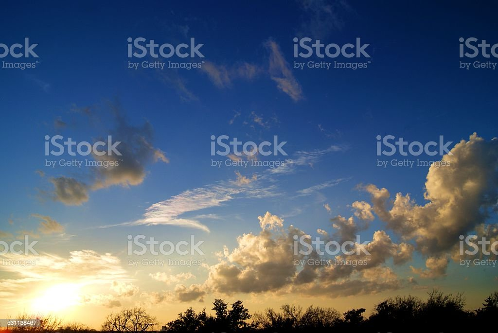 The Sun's Clouded Trail royalty-free stock photo