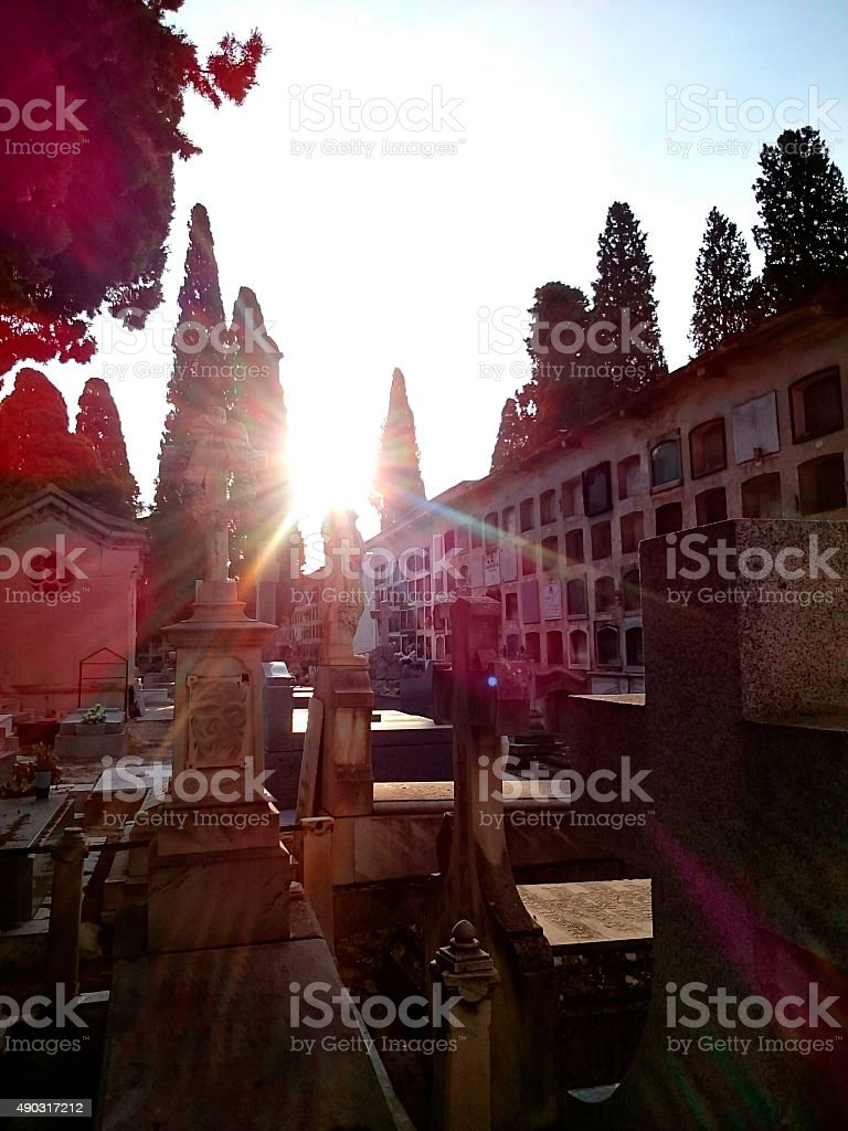 The sun's rays on the funerary sculpture in the tombs of the cemetery stock photo