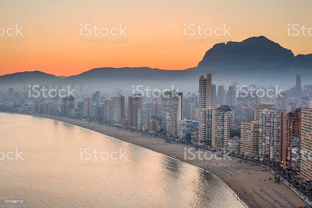 The sunset along the Benidorm skyline across the beach stock photo