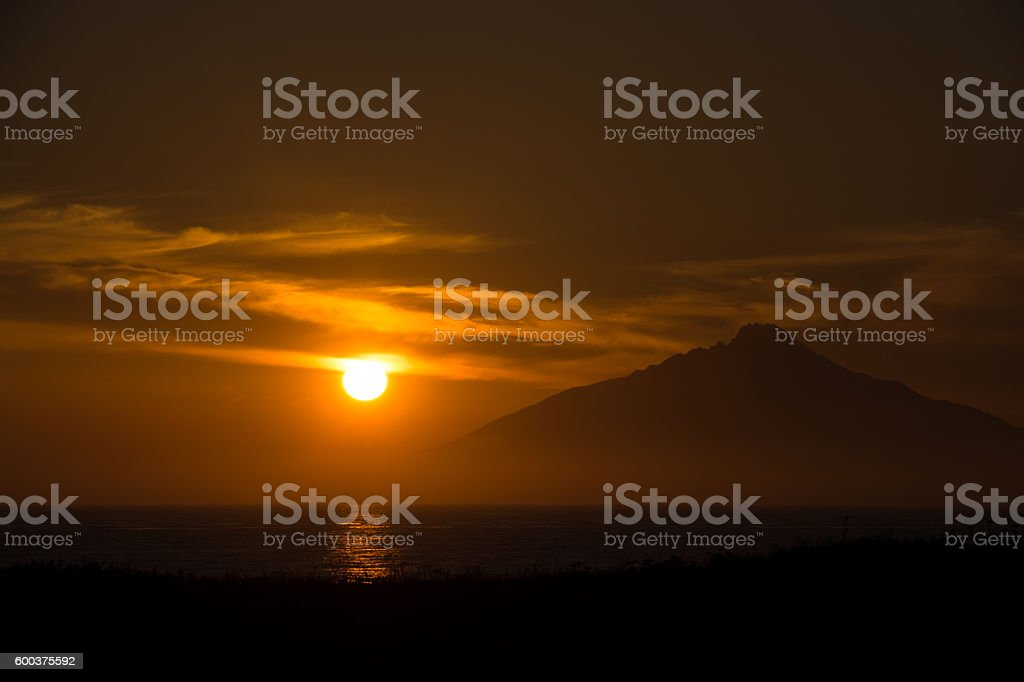 The sunset and silhouette of island stock photo