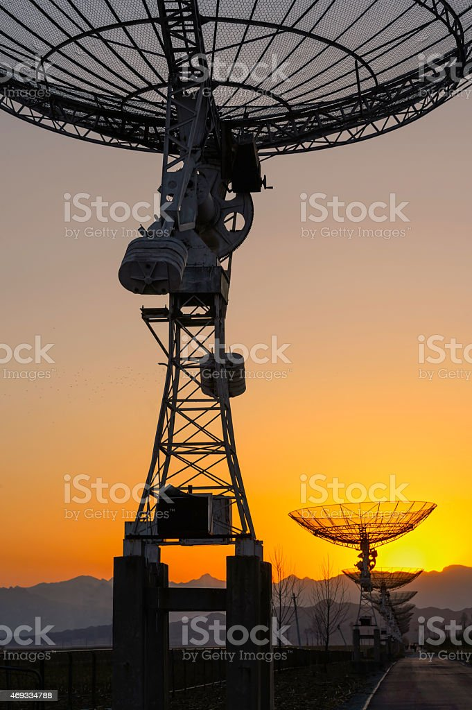 The sunset of satelite dishes stock photo