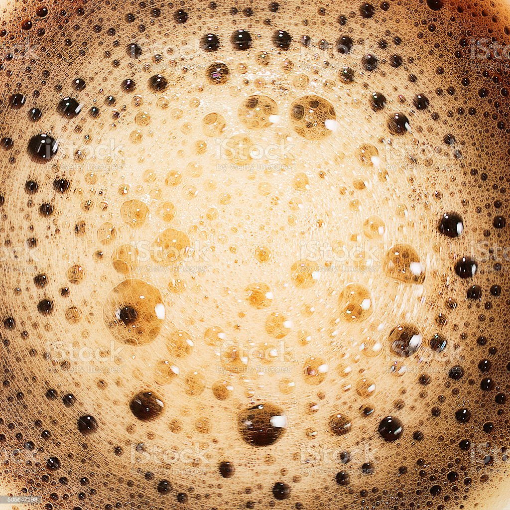 The surface of the hot coffee. Abstract background. macro stock photo