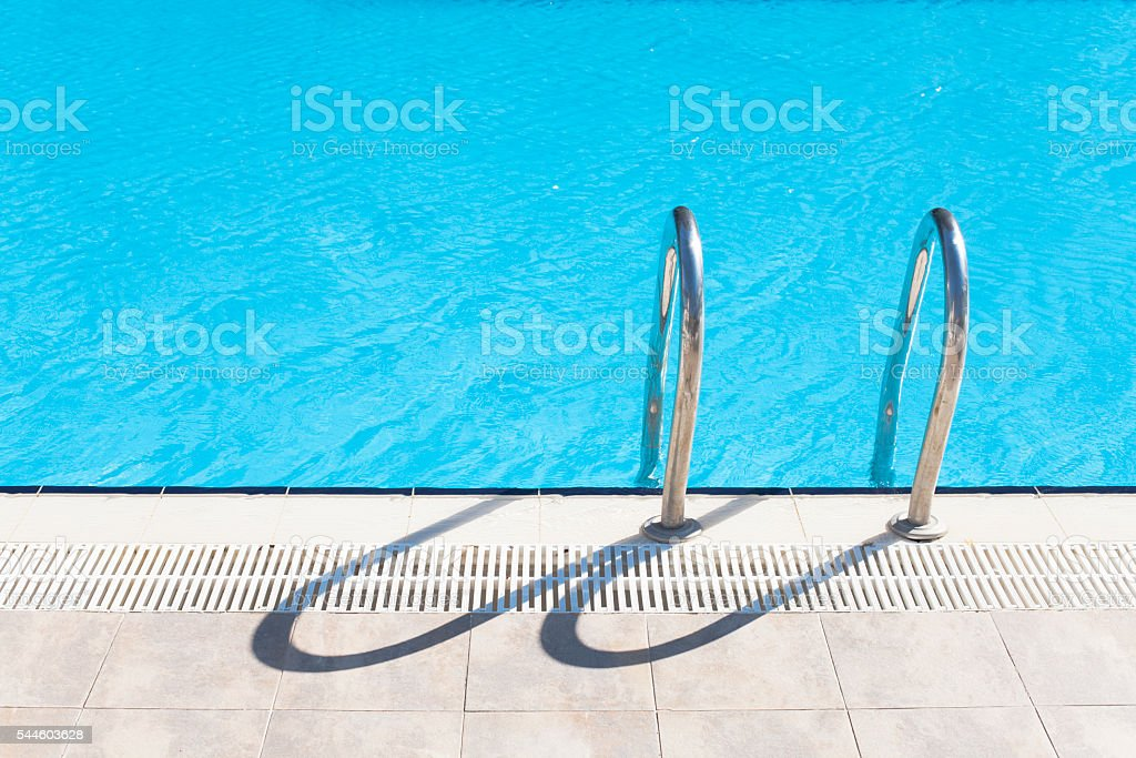 The swimming pool ladder stock photo