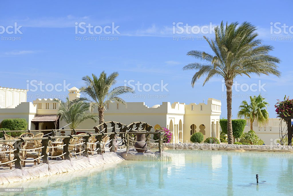 The swimming pool near outdoor restaurant at luxury hotel royalty-free stock photo