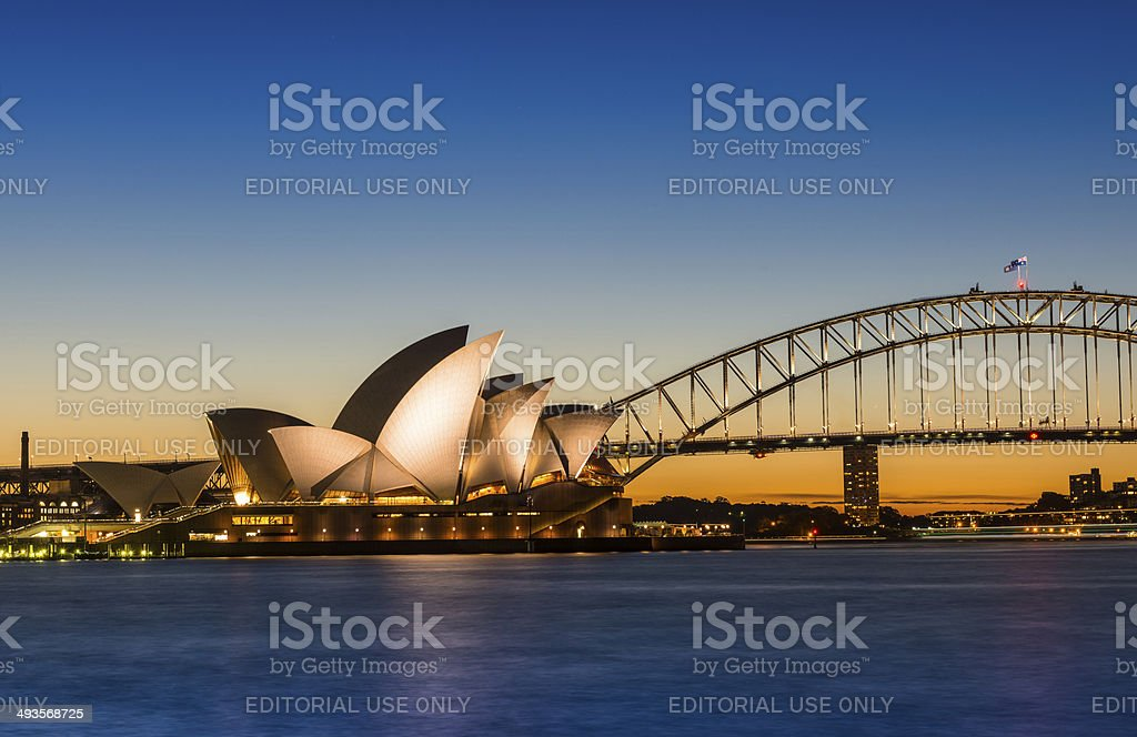 The Sydney Opera House with Harbor bridge in Australia stock photo