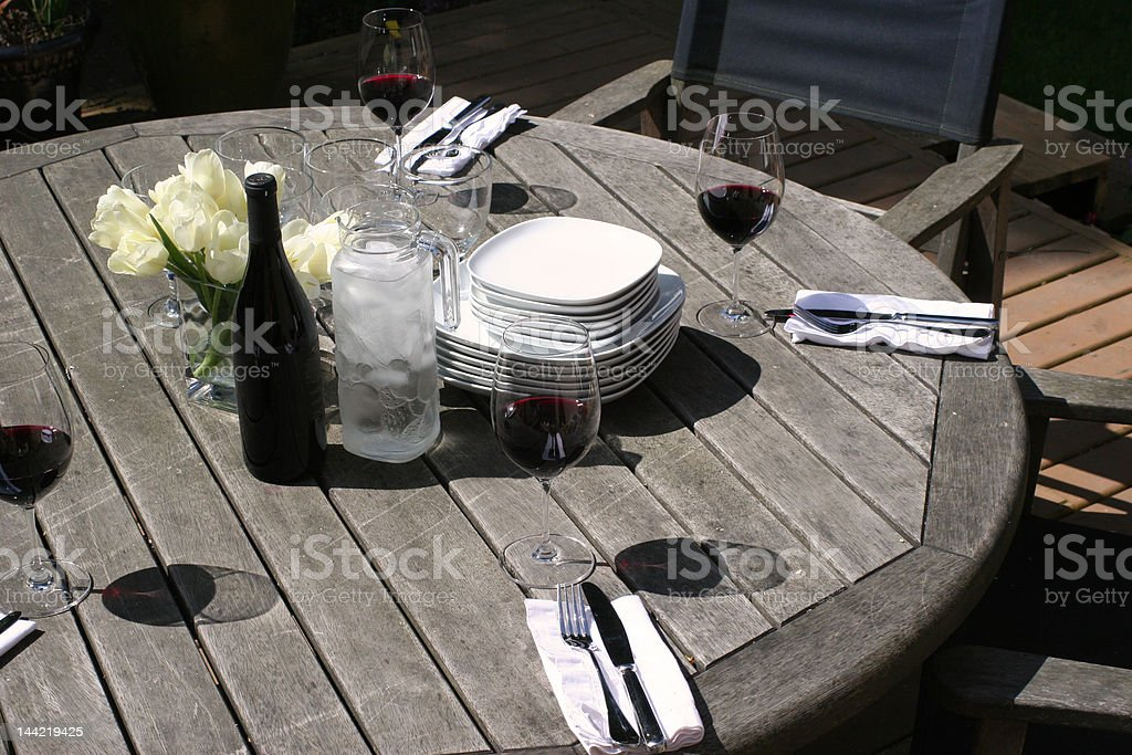 the table is set for outdoor dining royalty-free stock photo