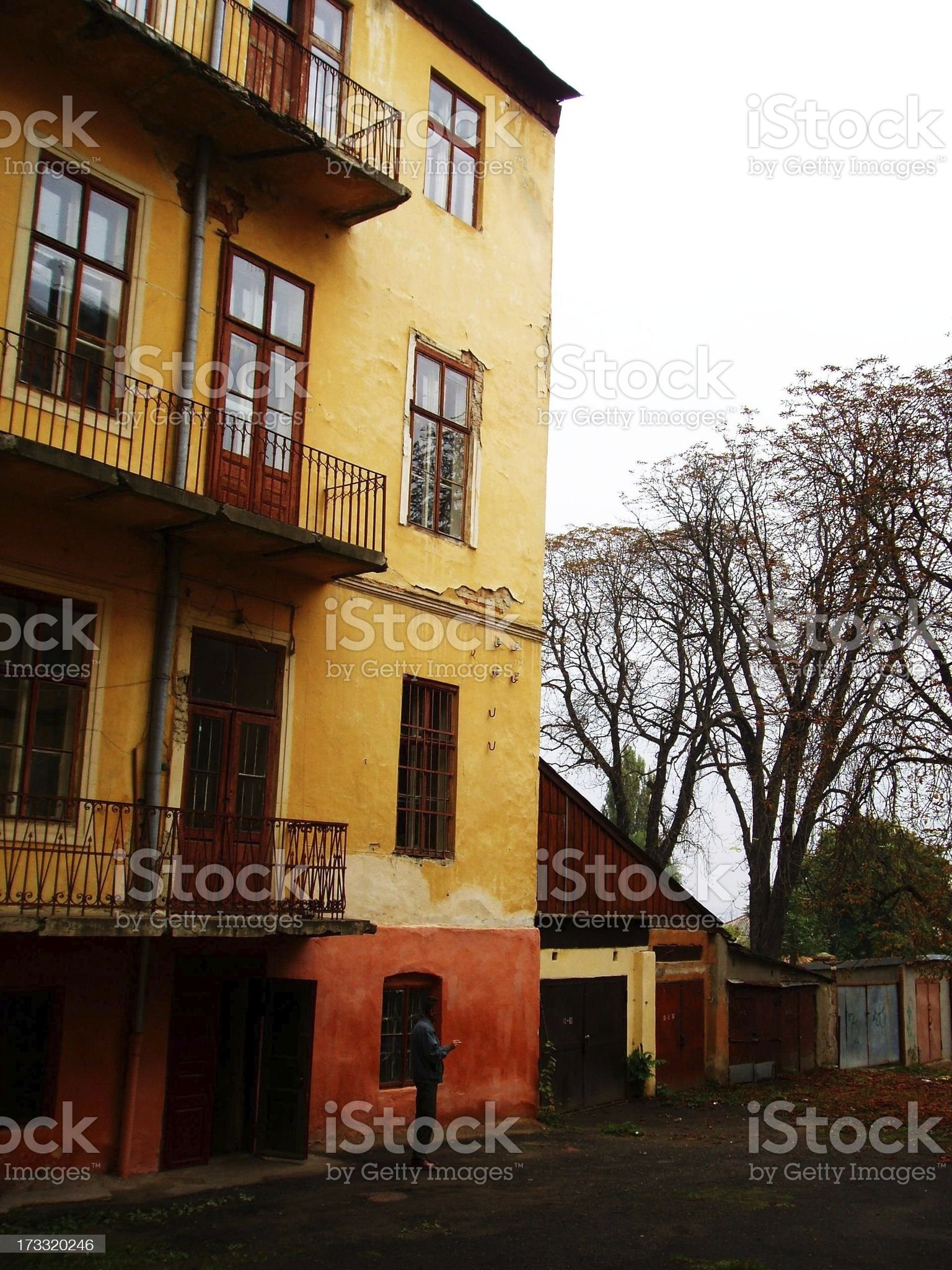 The tacky wall of simple yellow building royalty-free stock photo