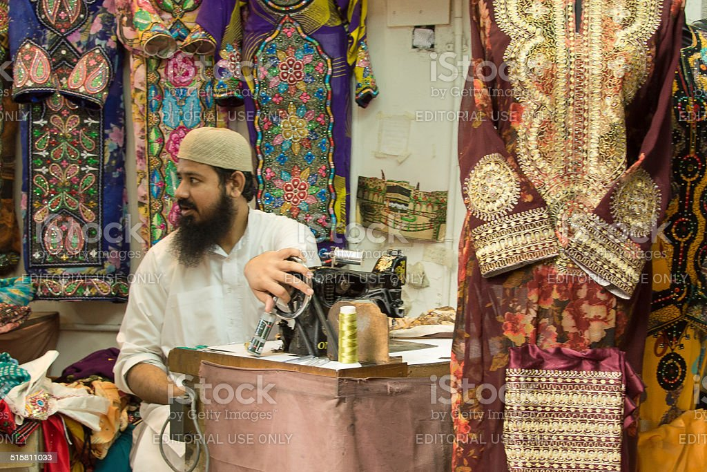 The tailor in the Mutrah souk, Muscat, Oman stock photo