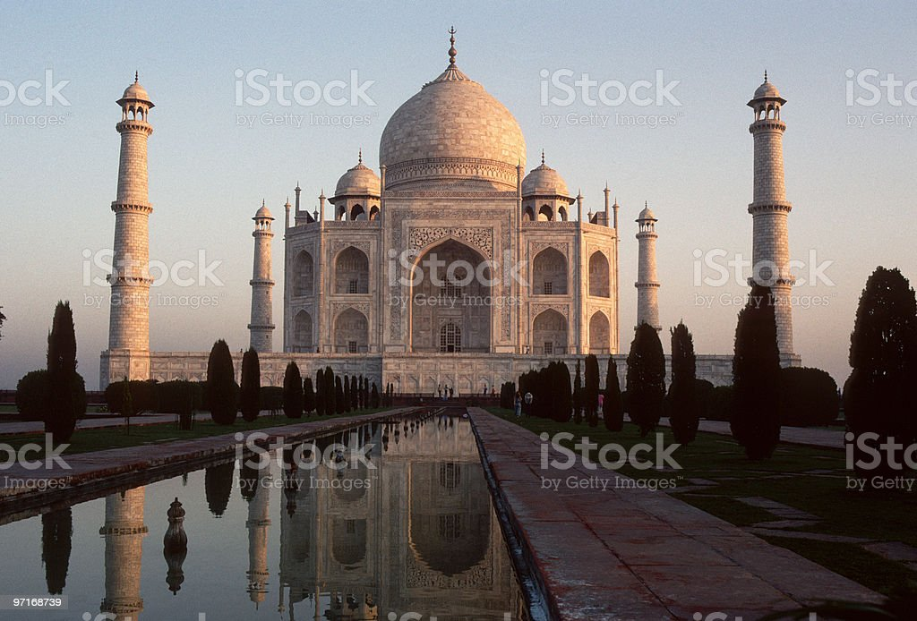 The Taj Mahal at sunrise on blue sky stock photo