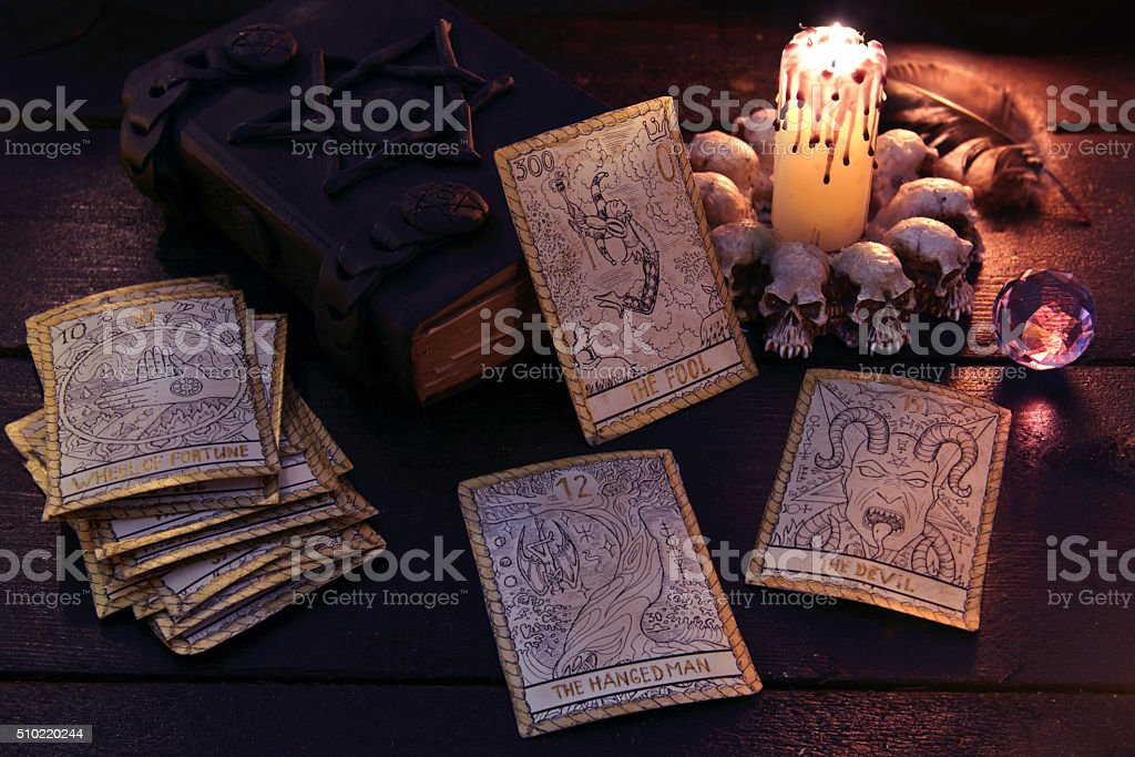 The tarot cards with crystal and book stock photo