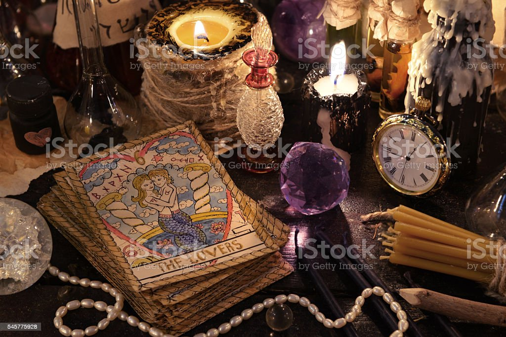 The tarot cards with crystal, candles and magic objects stock photo
