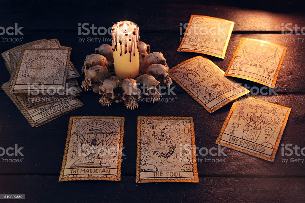 The tarot cards with evil candle stock photo