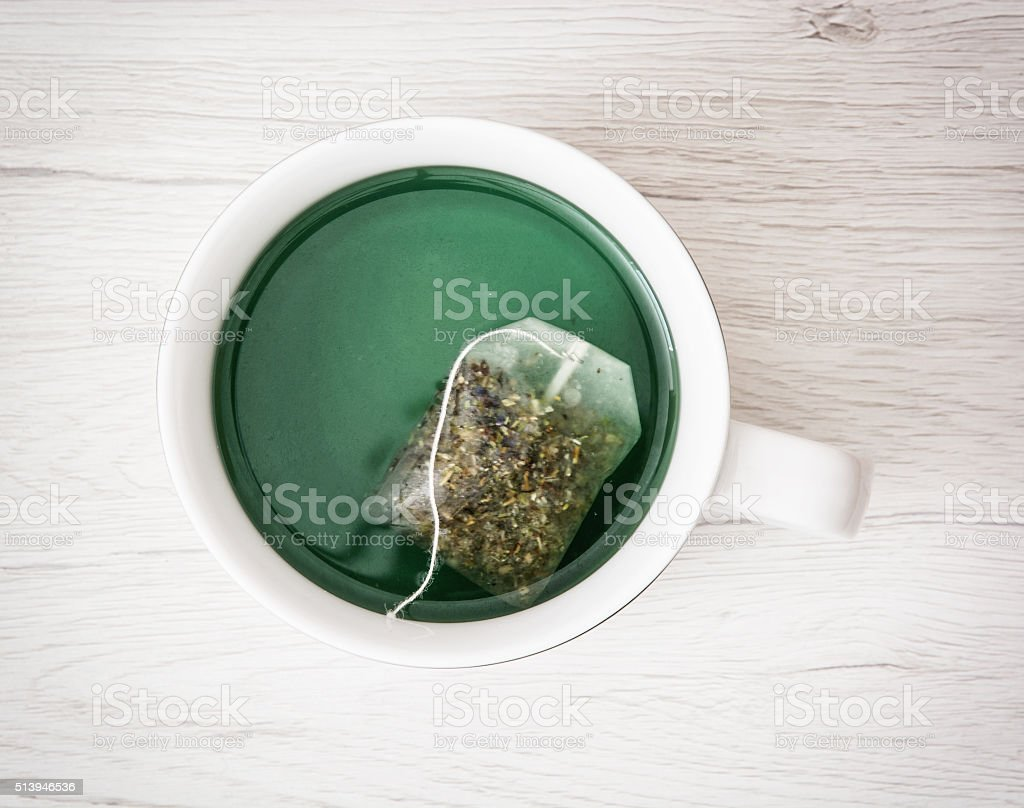 The tea bag is leaching in the cup stock photo