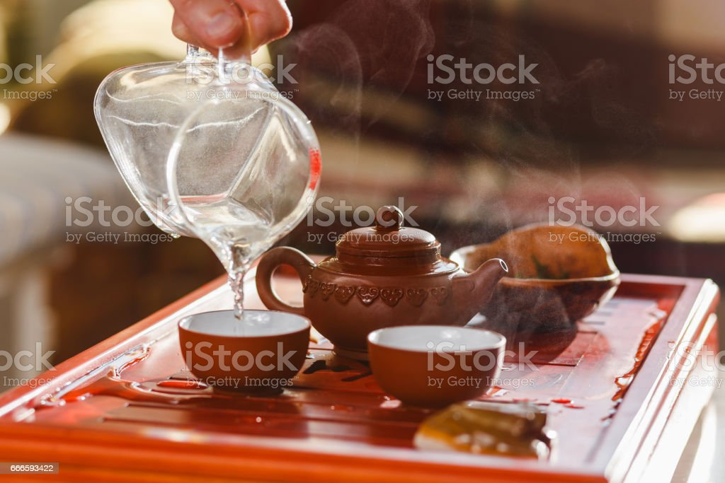 The tea ceremony. The woman rinses the bowls stock photo