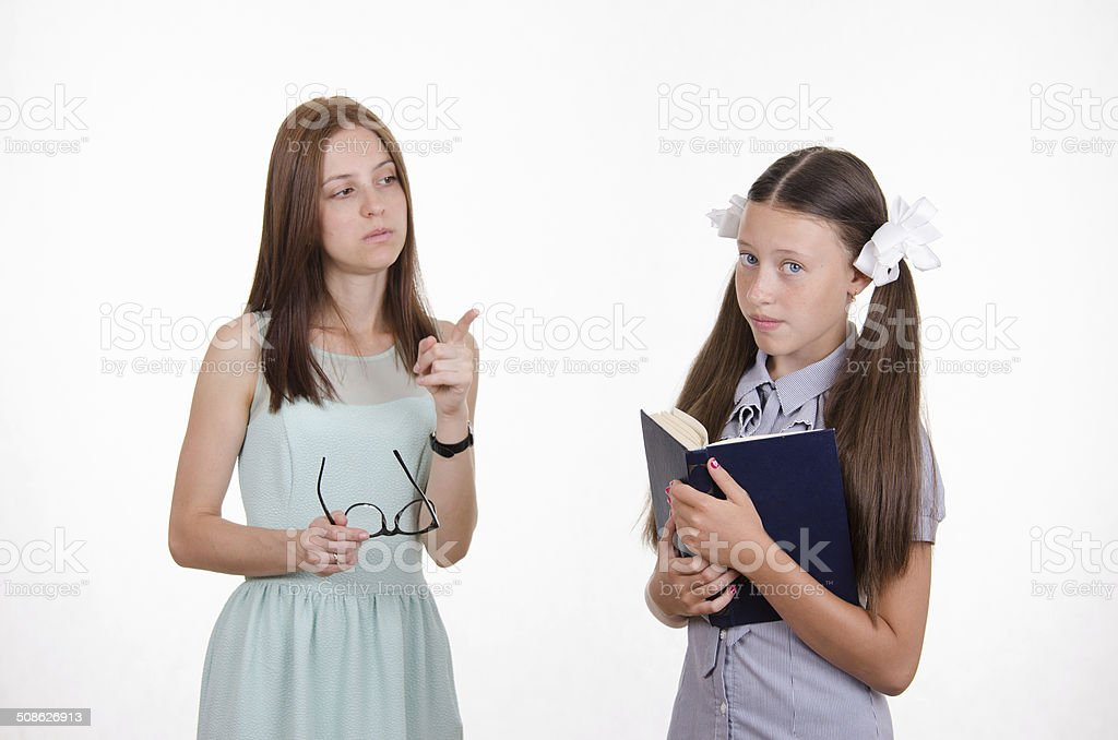 The teacher gives the student a mandate stock photo