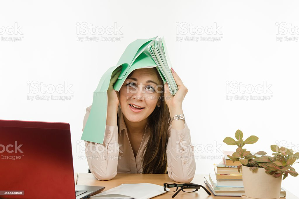The teacher is tired of the endless testing of notebooks stock photo