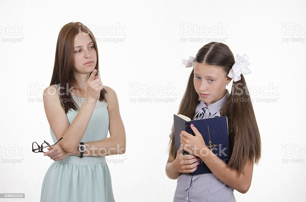 The teacher shakes his finger at the student stock photo