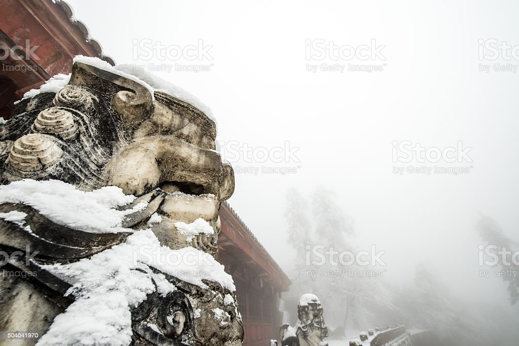 the temple(jieyindian) covered with snow on the Emei Mountain stock photo