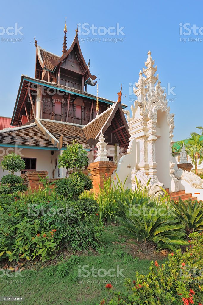 The temple is surrounded with fine tropical park stock photo