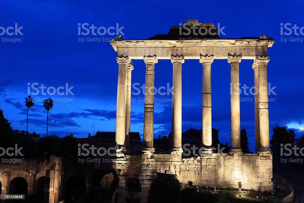 The Temple of Saturn by night at Roman Forum, Rome stock photo
