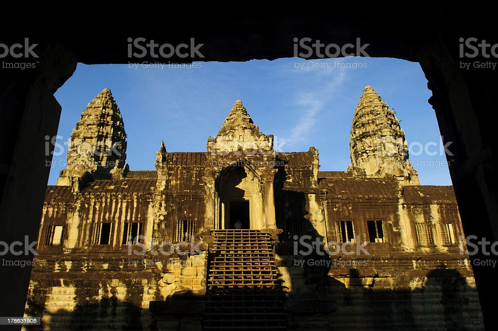 the temples of angkor wat through a gate royalty-free stock photo