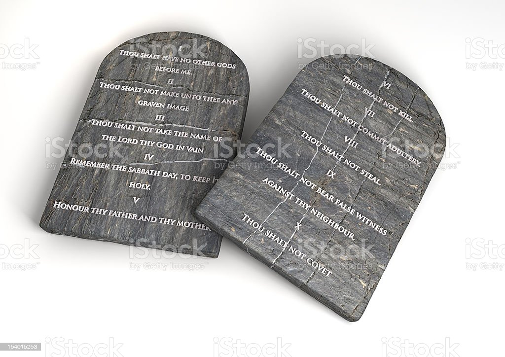 The Ten Commandments engraved in two pieces of flat stones stock photo
