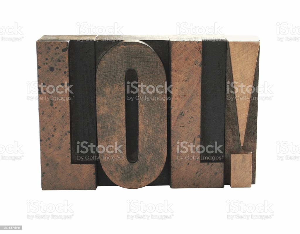 the term 'LOL' in old wood letterpress type royalty-free stock photo