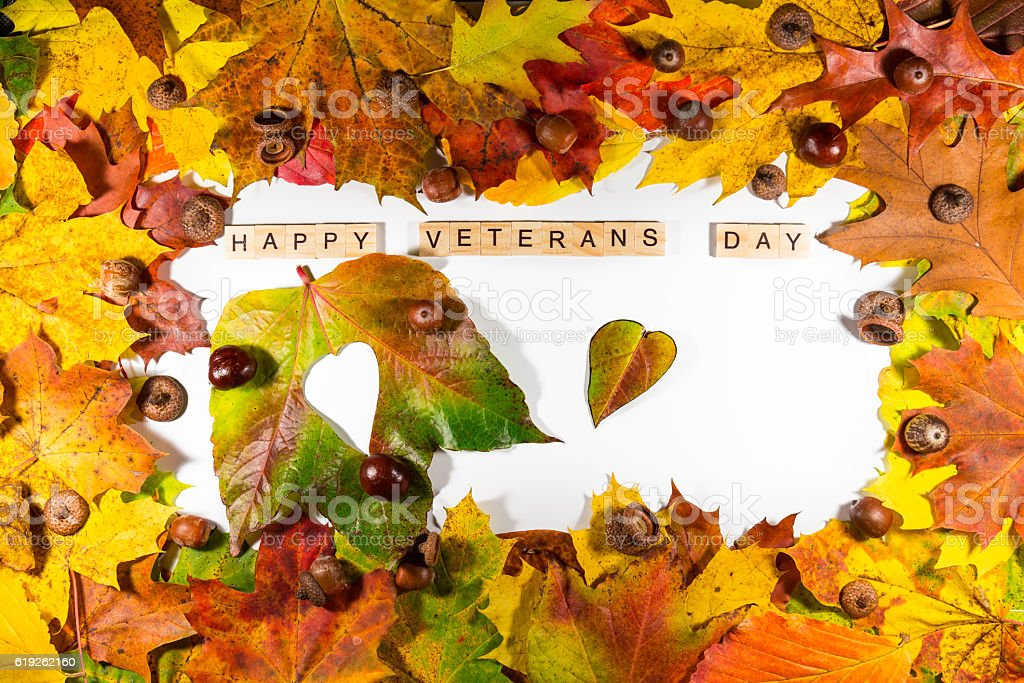 The text Happy Veterans Day written on a whiteboard stock photo