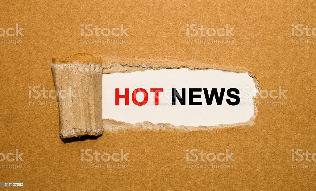 The text Hot News appearing behind torn brown paper stock photo