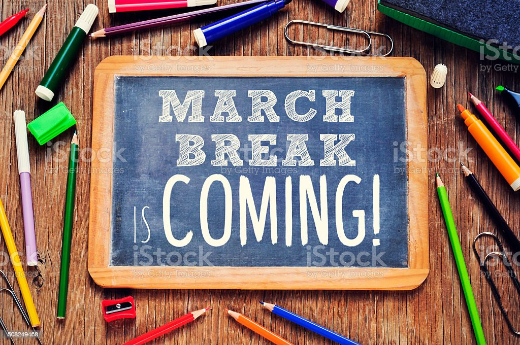 the text march break is coming written in a chalkboard stock photo