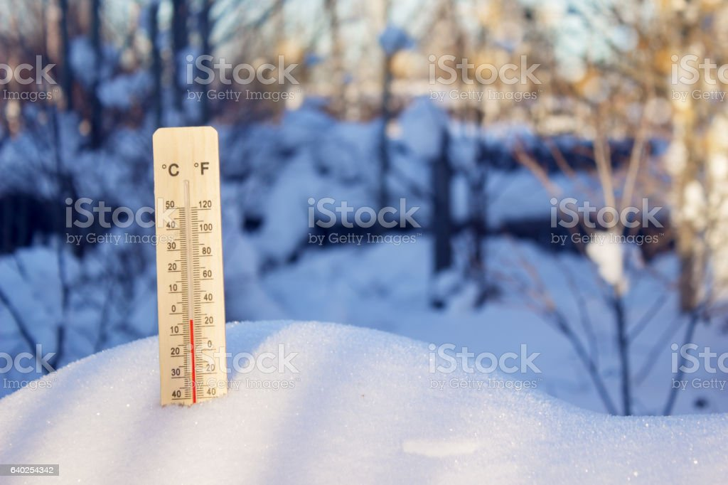 The thermometer on the outdoors in winter stock photo