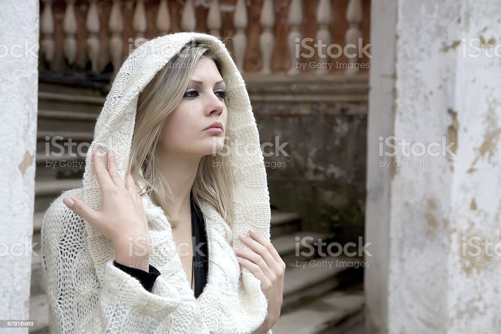 The thoughtful girl in  knitted dress stock photo