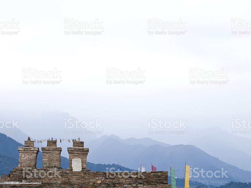 The three chortens with large prayer flags in Rabdentse (India) stock photo