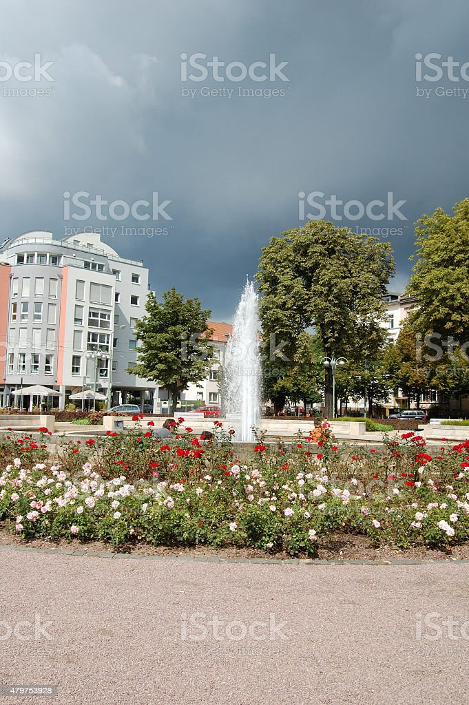 The thunderstorm coming to the fountain. stock photo