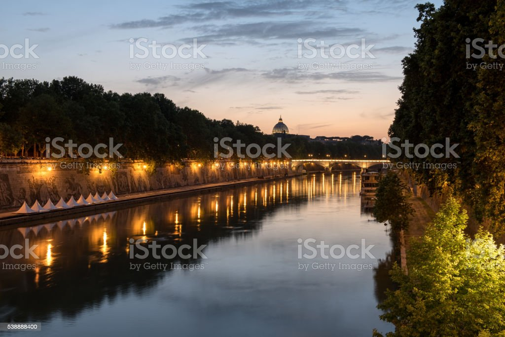 The Tiber river by night in Rome stock photo