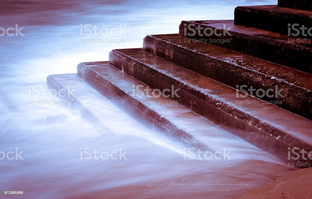 The tide flooded the stairs stock photo