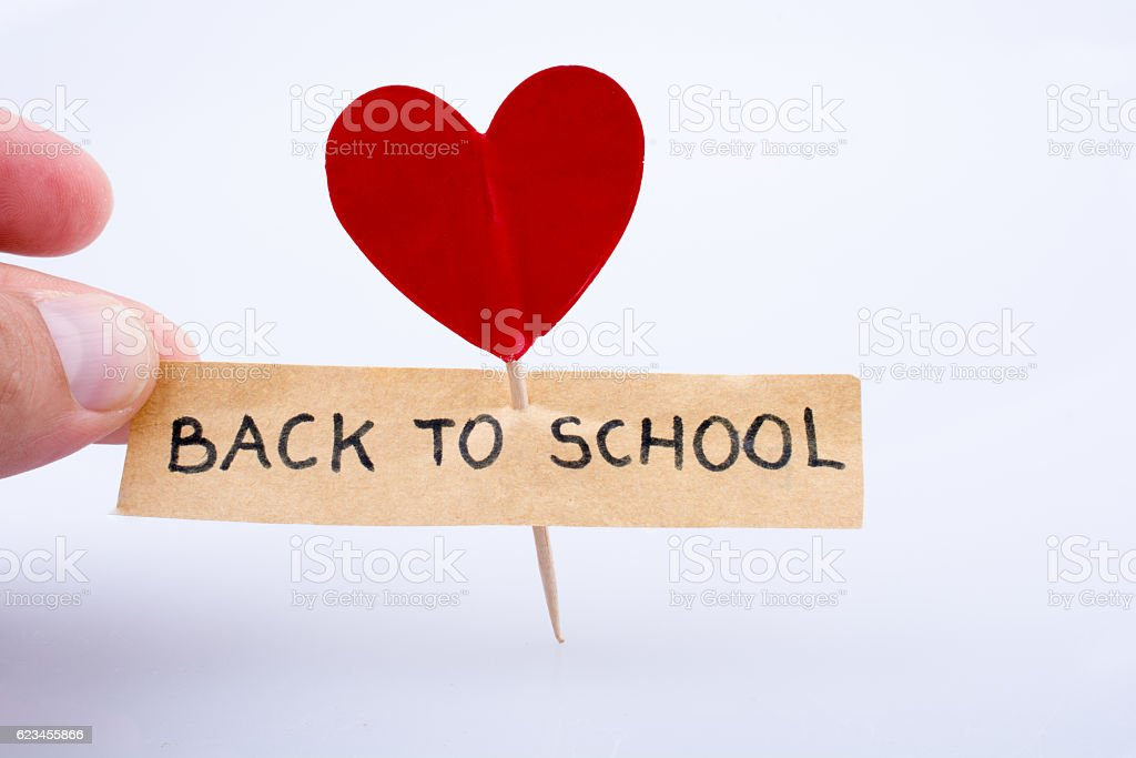 The  title back to school and a heart shape stock photo