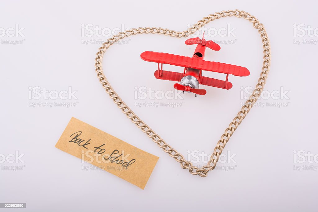 The  title back to school in heart and airplane stock photo