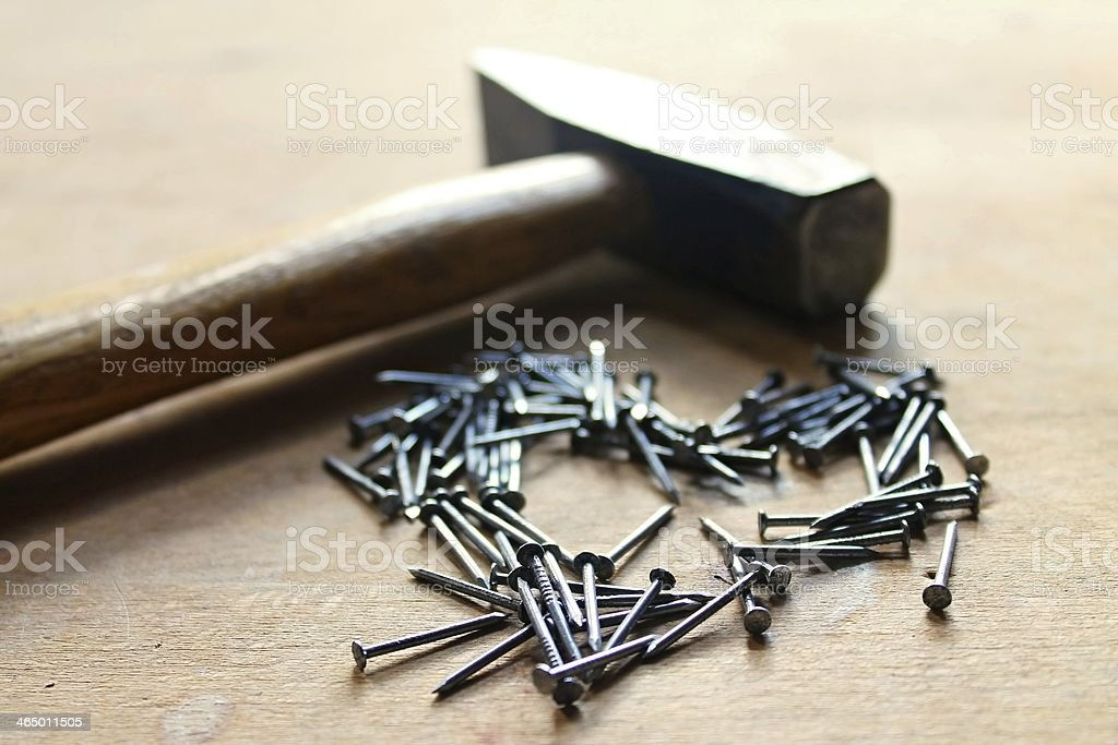 The tool shop romance with nails and hammer royalty-free stock photo