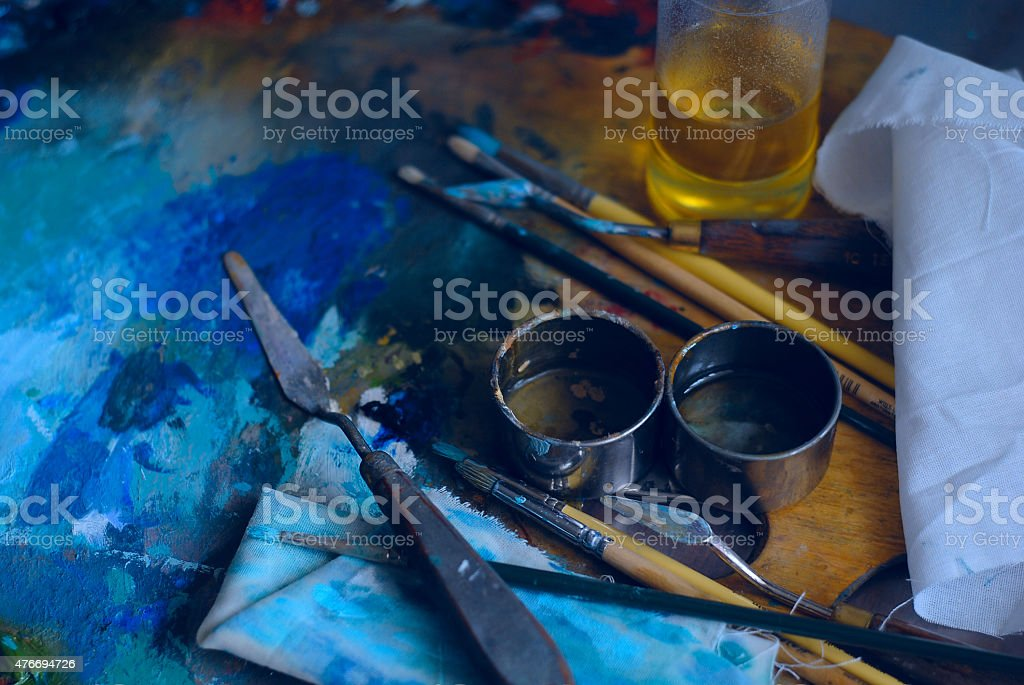 The tools of artist are on palette, the moment workflow stock photo