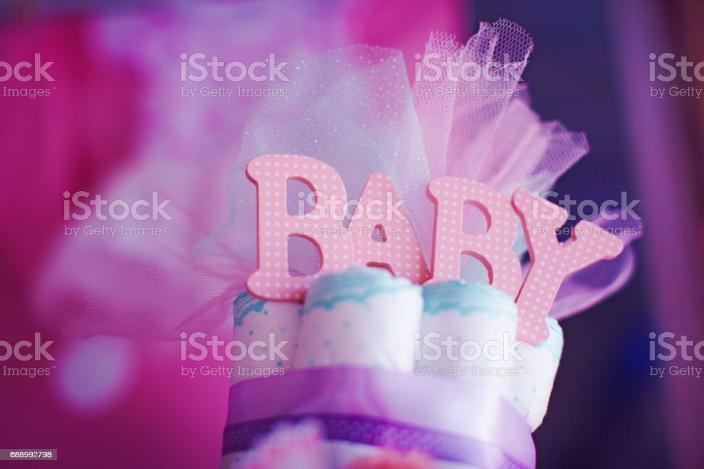 The top of cake made from kids diapers on baby shower celebration. stock photo