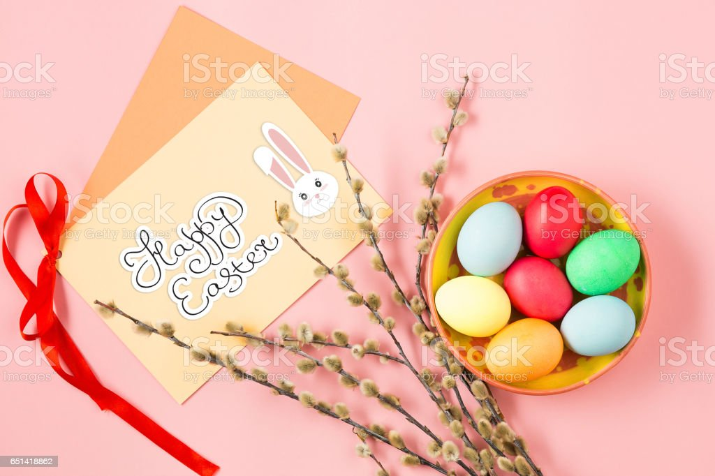 The top view of easter on pink table office workplace stock photo
