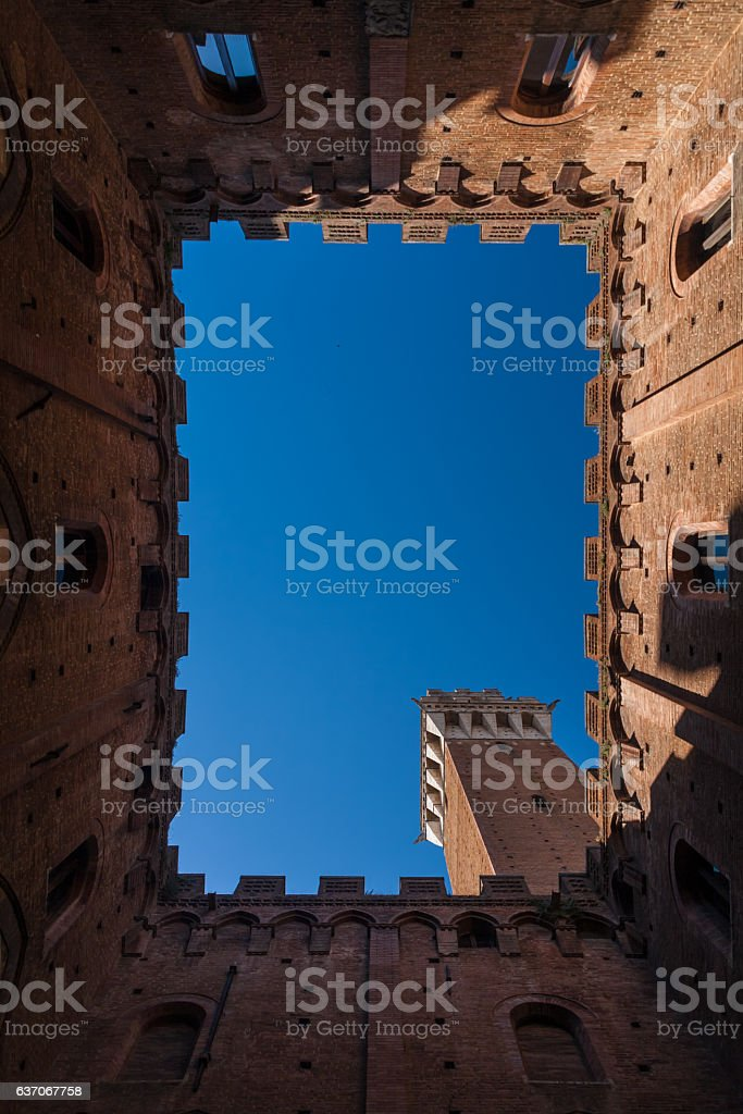 The Torre del Mangia is a tower in Siena, Italy stock photo